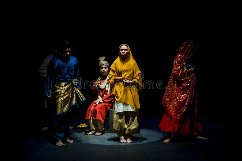 Performance on stage in dark studio stock image