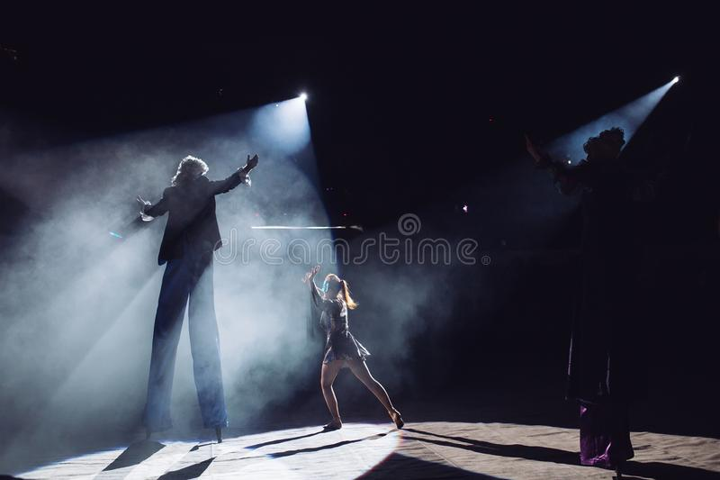 The performance of stilt-walkers in the circus.  stock images