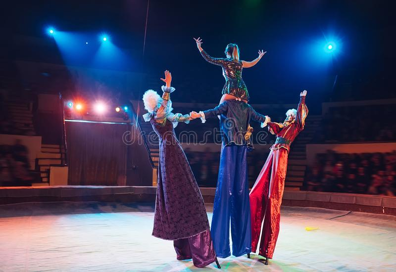 The performance of stilt-walkers in the circus.  stock image