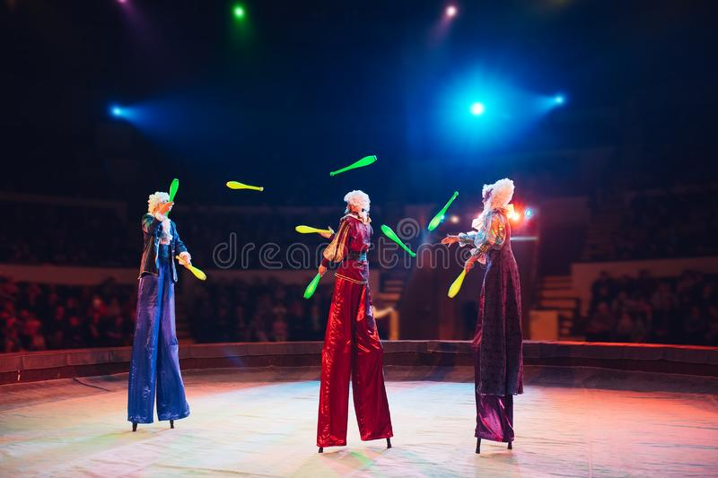 The performance of stilt-walkers in the circus.  royalty free stock photo