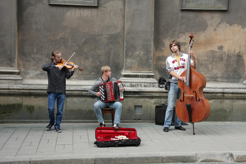 Performance of street musicians is in Lviv royalty free stock images