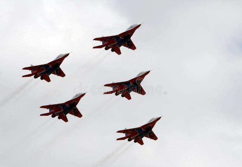 Performance of the Swifts aerobatic team on multi-purpose highly maneuverable MiG-29 fighters over the Myachkovo airfield. MOSCOW, RUSSIA APRIL 27, 2018 royalty free stock image