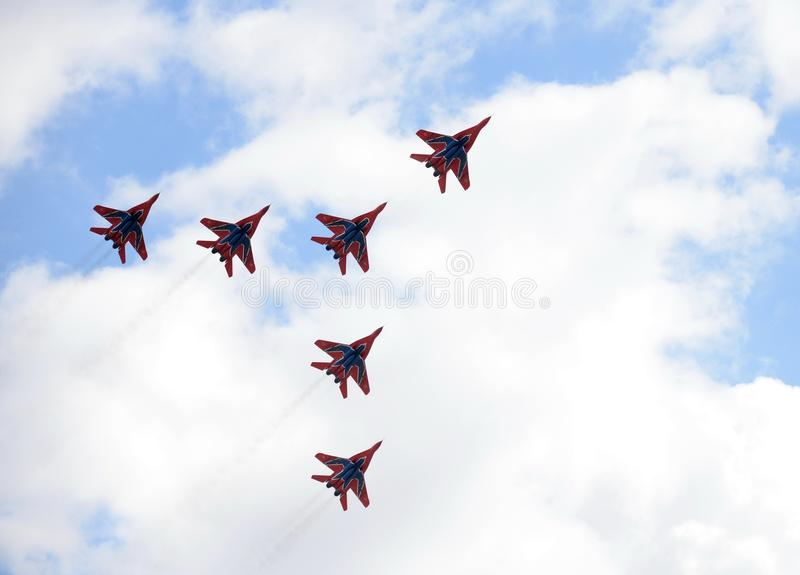 Performance of the Swifts aerobatic team on multi-purpose highly maneuverable MiG-29 fighters over the Myachkovo airfield. MOSCOW, RUSSIA APRIL 27, 2018 royalty free stock photos