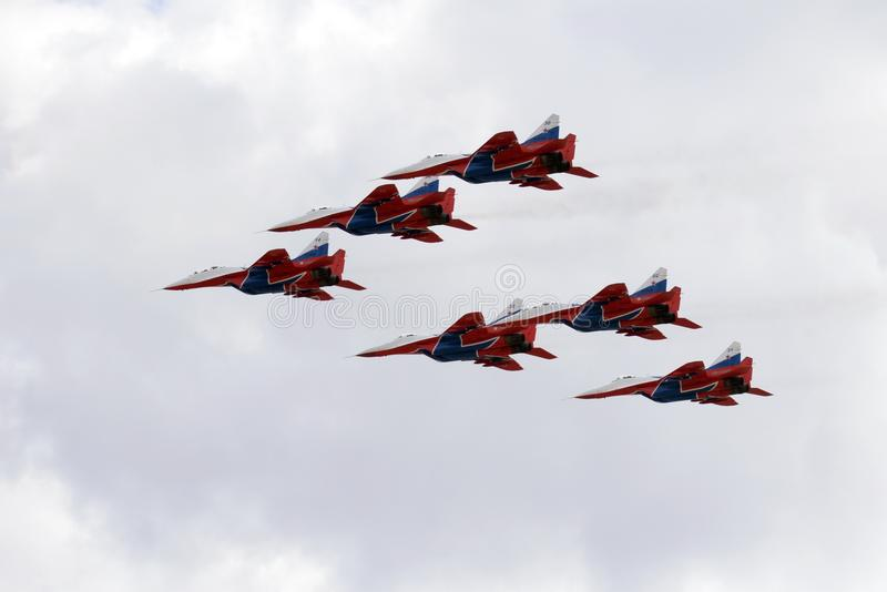 Performance of the Swifts aerobatic team on multi-purpose highly maneuverable MiG-29 fighters over the Myachkovo airfield. MOSCOW, RUSSIA APRIL 27, 2018 royalty free stock photo