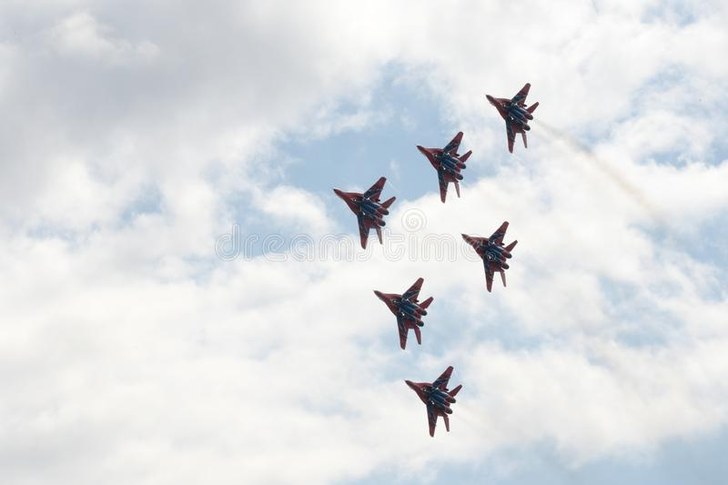 Performance of the Swifts aerobatic team on multi-purpose highly maneuverable MiG-29 fighters over the Myachkovo airfield. MOSCOW, RUSSIA APRIL 27, 2018 stock photography