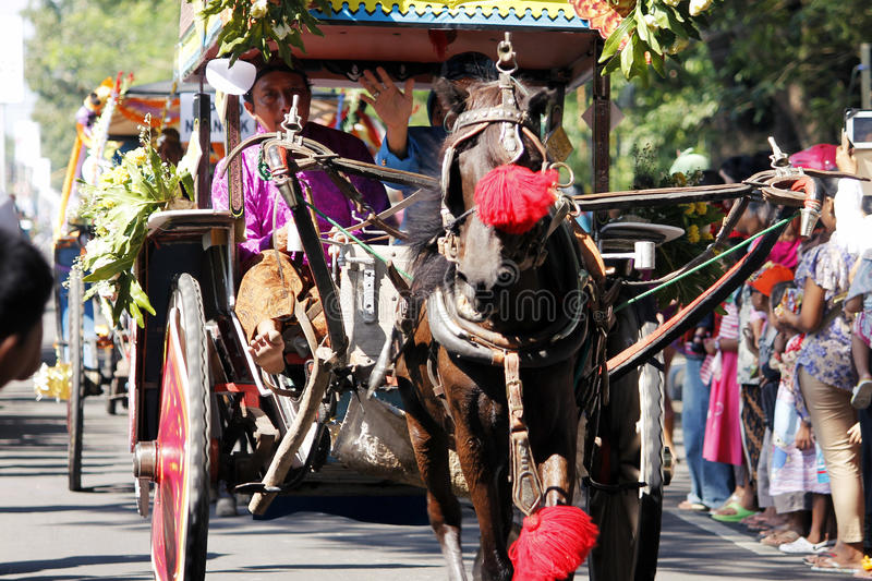 Performances anniversary carnival culture nganjuk city, East Java, Indonesia. With around town using traditional vehicles decorated horse cart exciting. on 18 stock images
