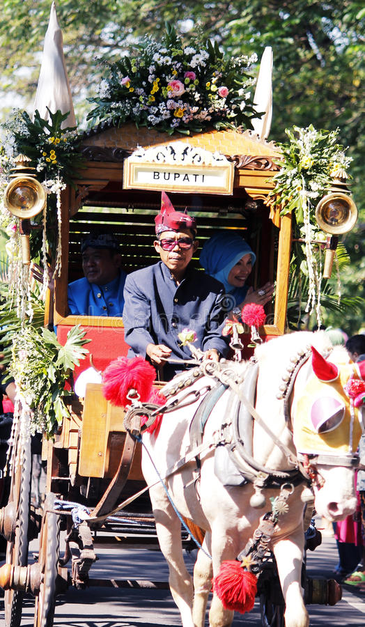 Performances anniversary carnival culture nganjuk city, East Java, Indonesia. With around town using traditional vehicles decorated horse cart pull, father and royalty free stock images