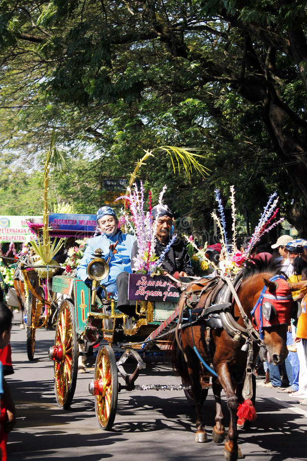 Performances anniversary carnival culture nganjuk city, East Java, Indonesia. With around town using traditional vehicles decorated horse cart exciting. on 18 royalty free stock image