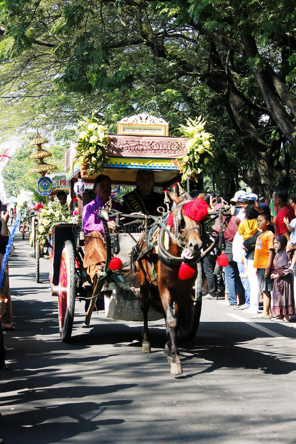 Performances anniversary carnival culture nganjuk city, East Java, Indonesia. With around town using traditional vehicles decorated horse cart exciting. on 18 royalty free stock photo