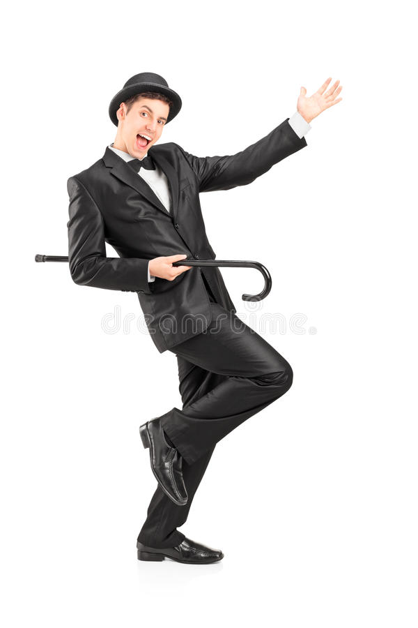 Performer dancing with a cane. Full length portrait of a performer dancing with a cane on white background stock photos