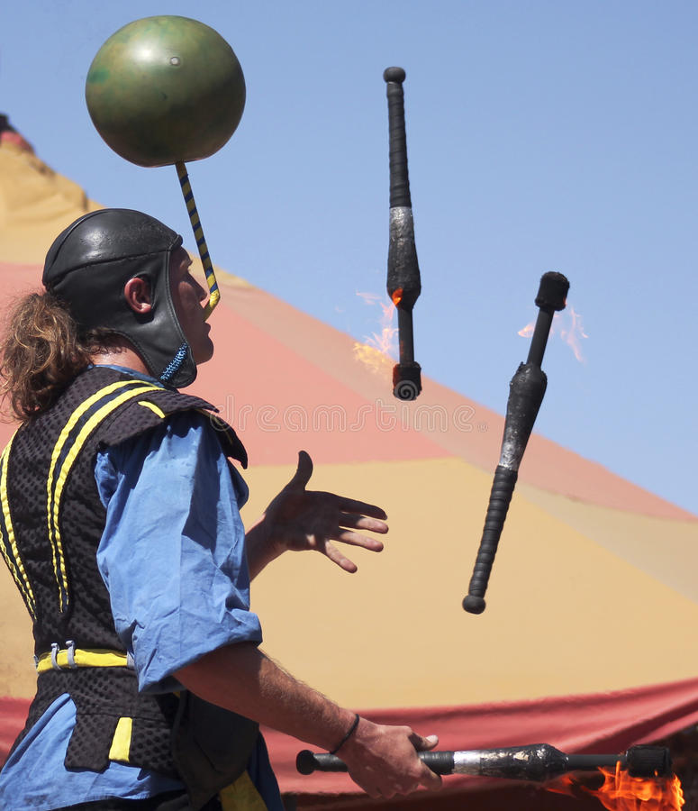 A Performer Juggles Fire at the Arizona Renaissance Festival. Apache Junction, Arizona - March 14: The Arizona Renaissance Festival on March 14, 2015, near stock photography