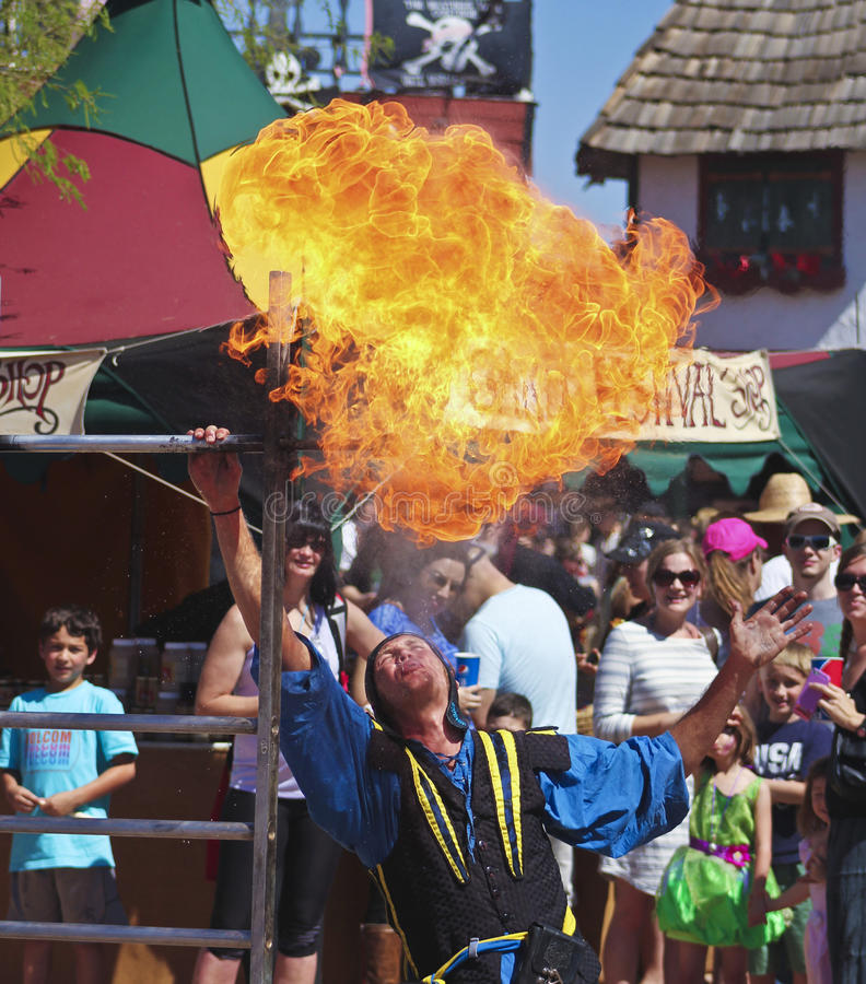 A Performer Spits Fire at the Arizona Renaissance Festival. Apache Junction, Arizona - March 14: The Arizona Renaissance Festival on March 14, 2015, near Apache royalty free stock photography
