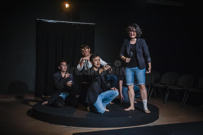 Performers acting on stage in dark studio stock image