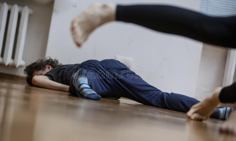 Dancers foots, legs, on floor. Performers foots, legs, on blured background. dancer improvise,on floor, dance performance improvisation stock images