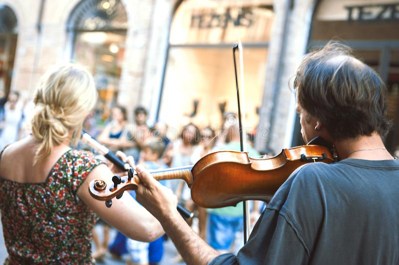 Performers of street artists violinist during the Busker Festiva stock images