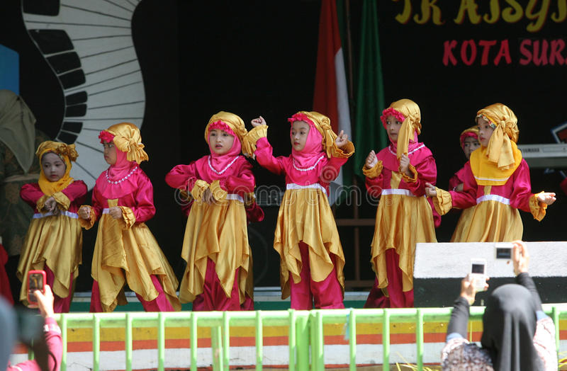 Performing art. Kindergarten students perform on a stage performing arts in the city of Solo, Central Java, Indonesia royalty free stock images
