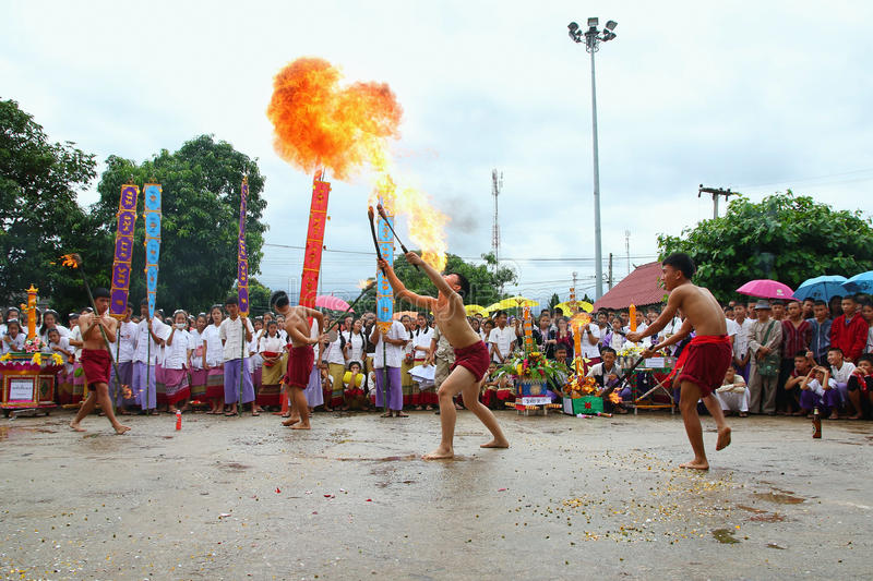 Performing arts fire sword dance, cultural Traditions. Chiang Mai, Thailand - July 29, 2015: Performing arts fire sword dance, The arts of the ancient Lanna or royalty free stock photos
