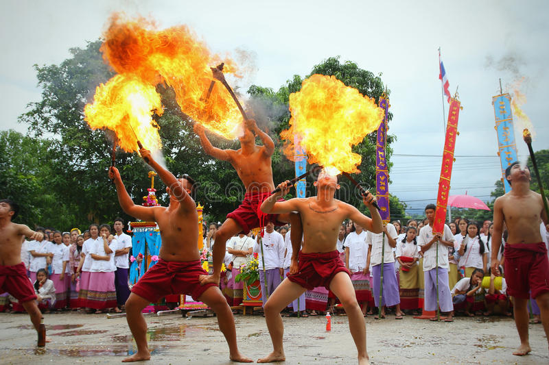 Performing arts fire sword dance, cultural Traditions. Chiang Mai, Thailand - July 29, 2015: Performing arts fire sword dance, The arts of the ancient Lanna or stock photos