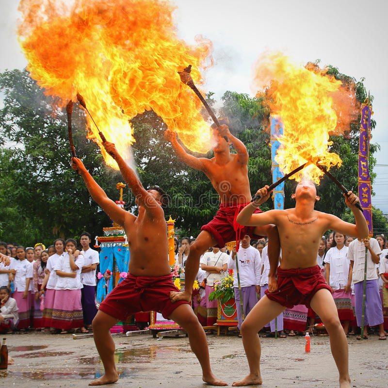 Performing arts fire sword dance, cultural Traditions. Chiang Mai, Thailand - July 29, 2015: Performing arts fire sword dance, The arts of the ancient Lanna or stock photo