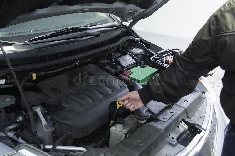 Performing car repair in a home garage to provide safe transportation. Vehicle is in a shop for repair and periodic maintenance royalty free stock images