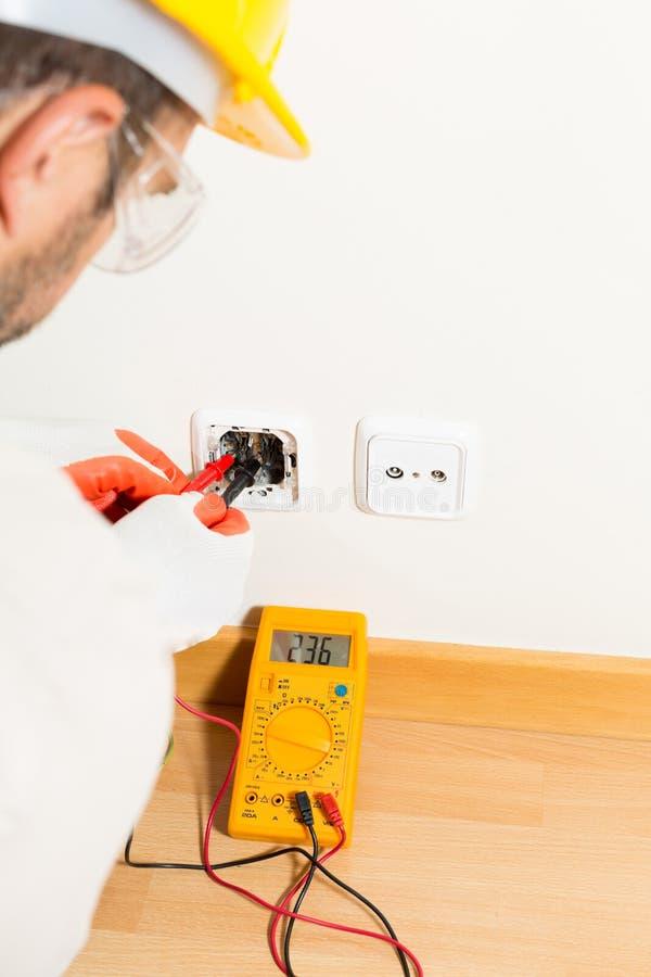 Performing a repair electrician stock photos