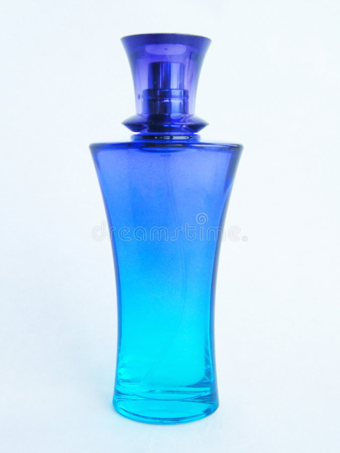 Perfum. Blue bottle with perfum on a white background stock image