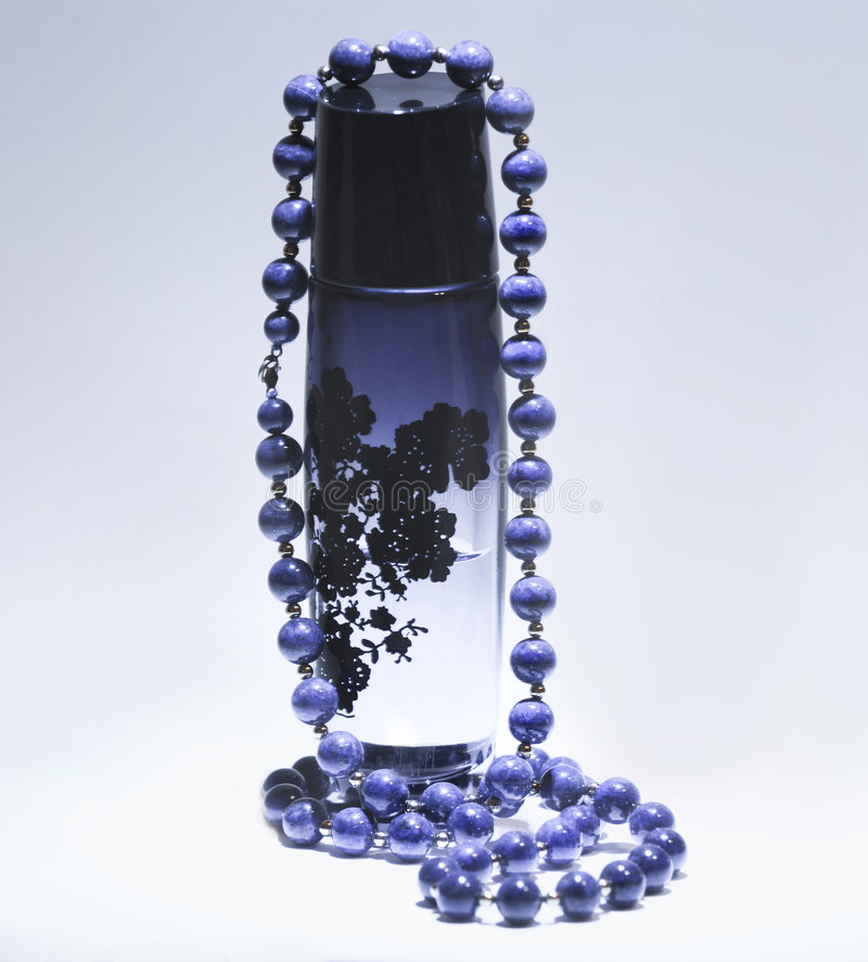 Perfume and blue pearls stock photos