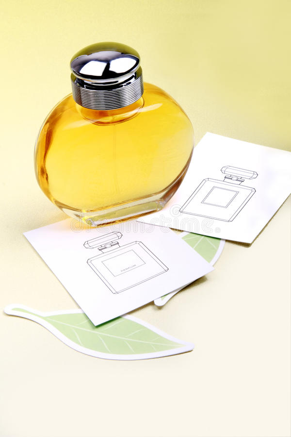Perfume bottle. A bottle of top-grade perfume and manual on the background stock image