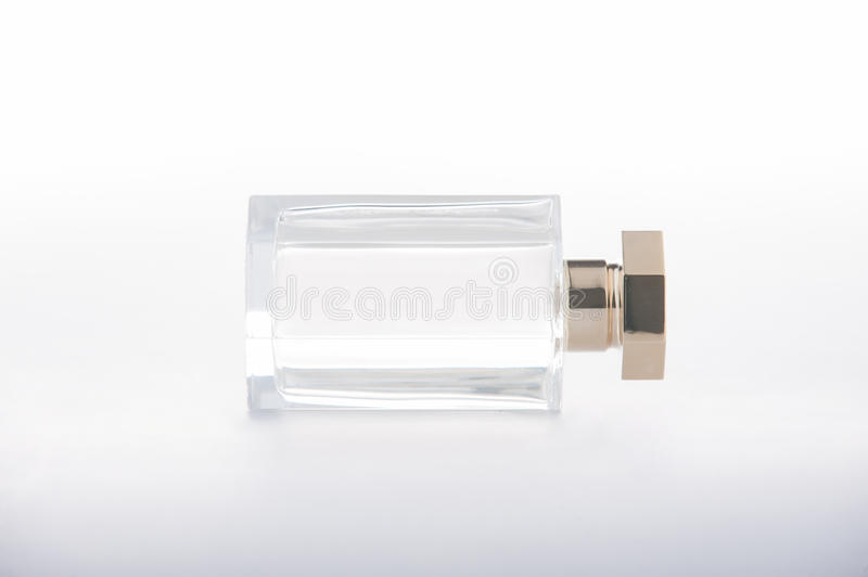 Perfume bottle in the gold color royalty free stock images