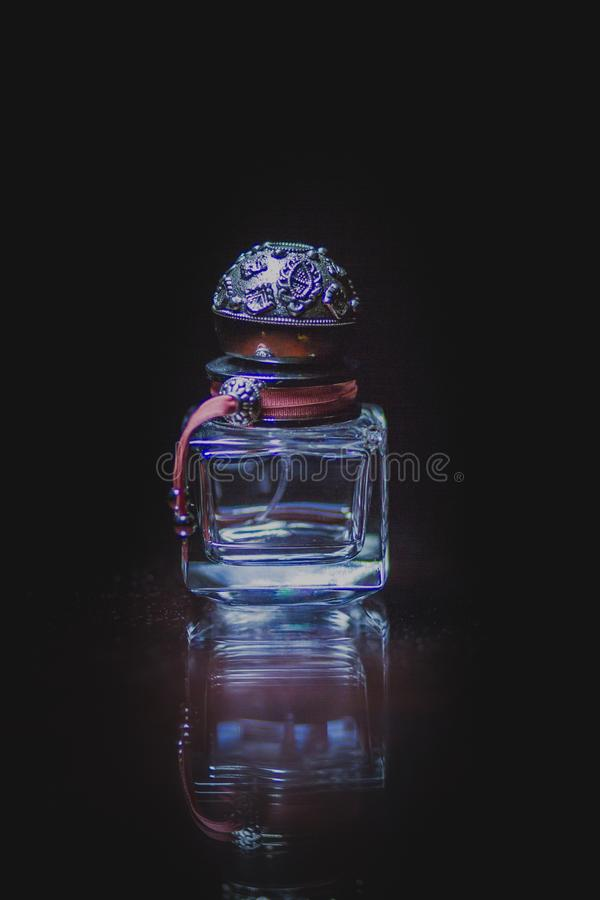 Perfume bottle left over stock photography
