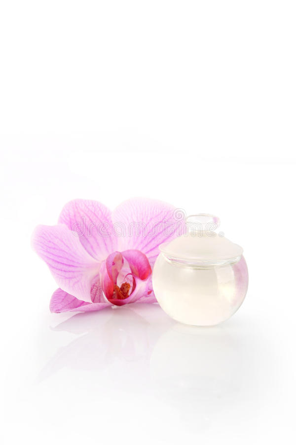 Perfume bottle and orchid flower stock photo