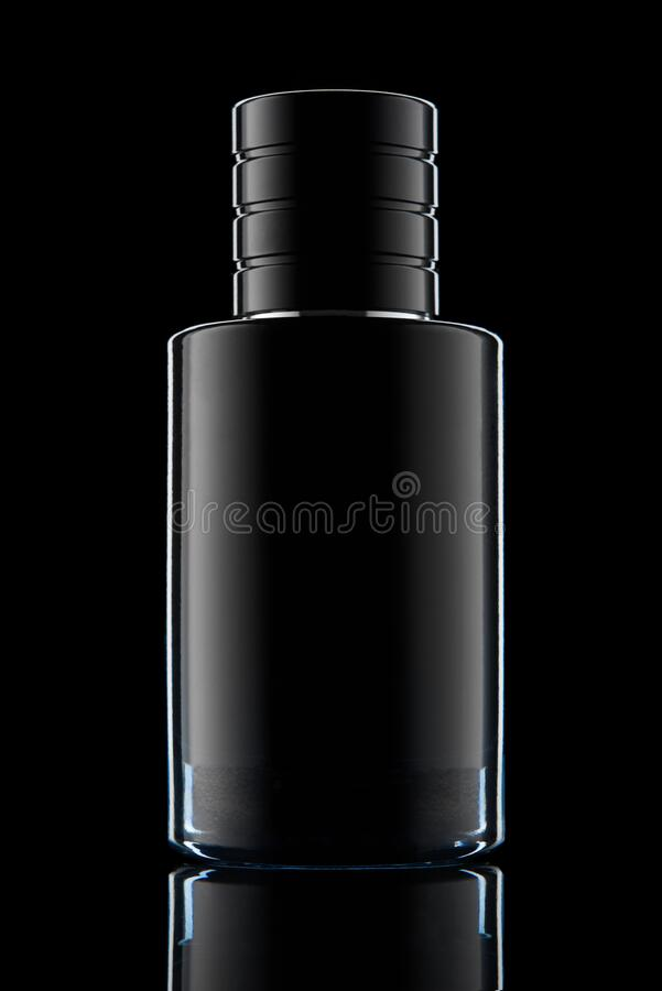 Perfume bottle over a black royalty free stock image