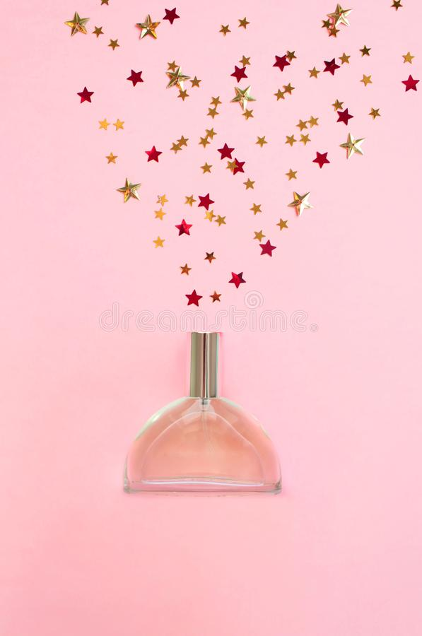 Perfume bottle on pink background. Flat lay royalty free stock images