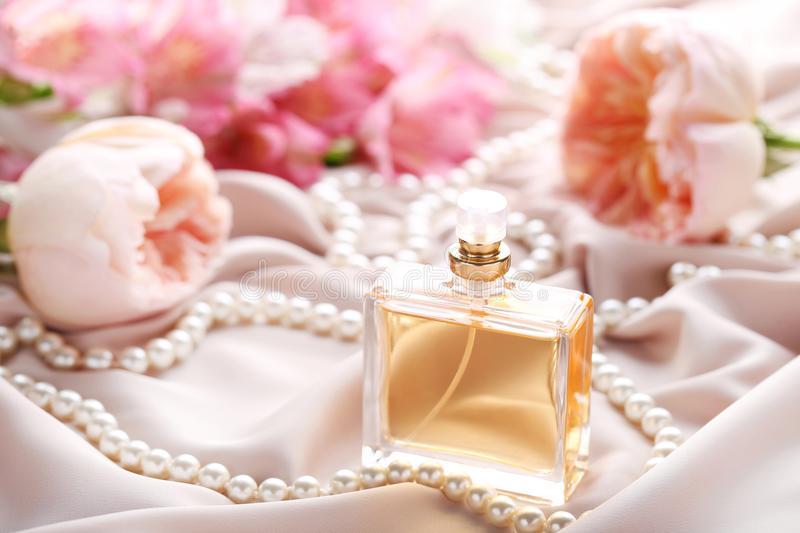 Perfume bottle with roses royalty free stock image