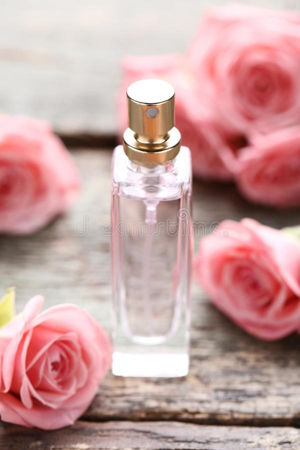 Perfume bottle with roses stock photo