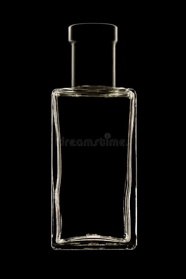 Perfume bottle silhouette. Image of perfume bottle silhouette on black background stock image