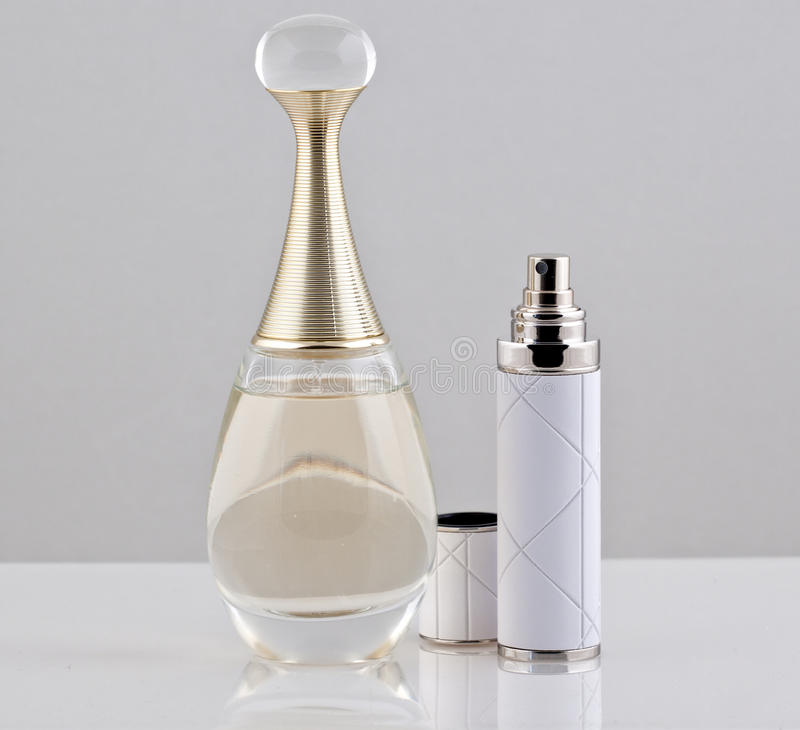 Perfume bottle and spray stock images