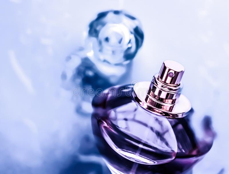 Perfume bottle under purple water, fresh sea coastal scent as glamour fragrance and eau de parfum product as holiday gift, luxury royalty free stock photo
