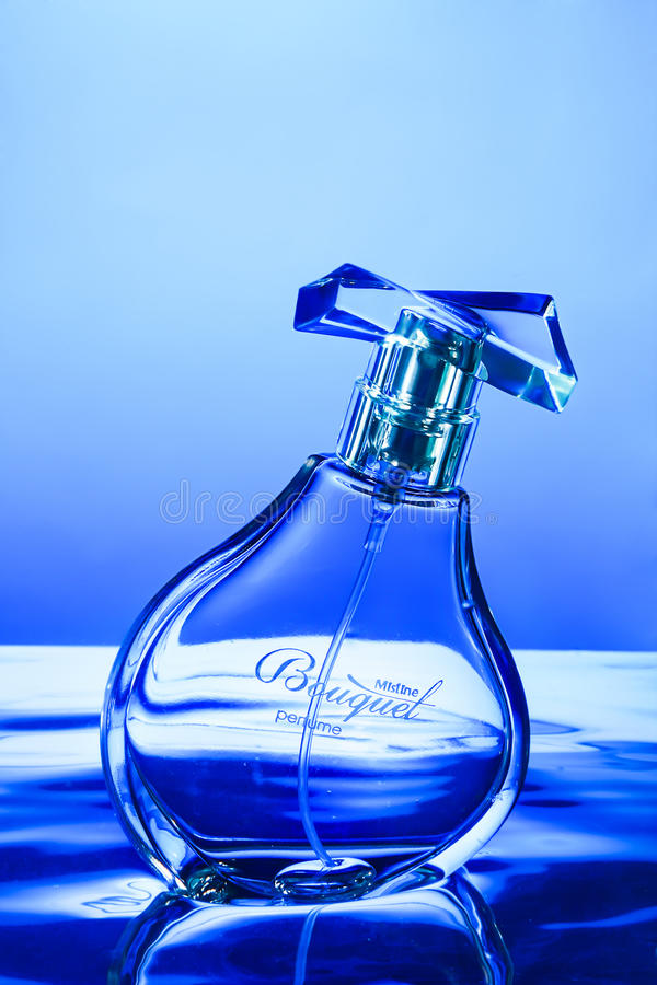 Perfume bottle on water. royalty free stock images