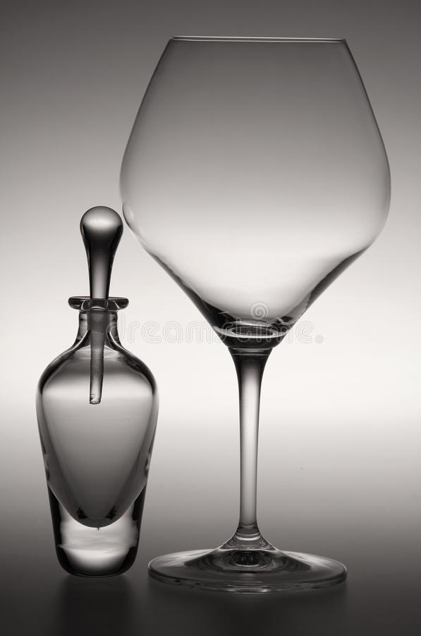 A perfume bottle and a wine glass stock photography