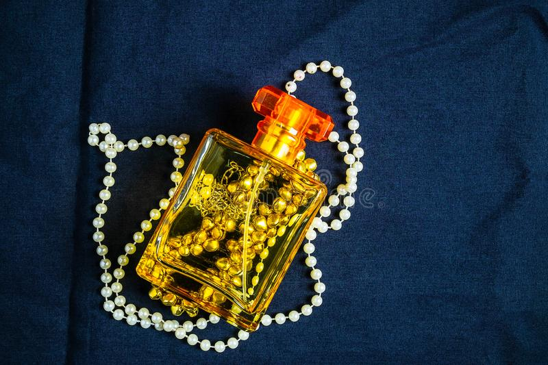 Perfume bottles and fragrances with beautiful jewelry.  stock photos