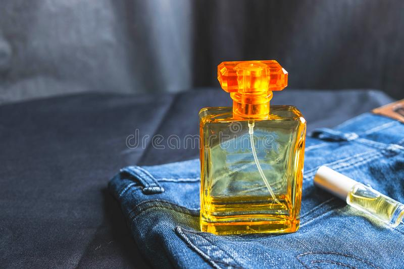 Perfume bottles and fragrances in jeans bags. Perfume bottles and fragrances in jeans bags royalty free stock photos