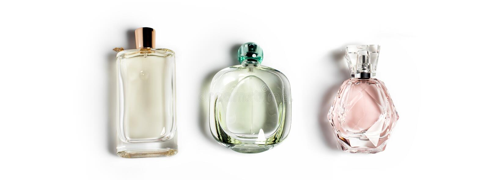 Perfume bottles on light background. Perfumery, cosmetics, fragrance collection. Banner for website. Perfume bottles on light background. Perfumery, cosmetics royalty free stock images