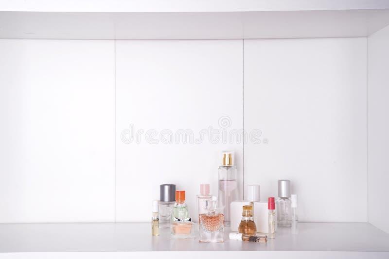 Set of various woman perfumes o white background. stock photos