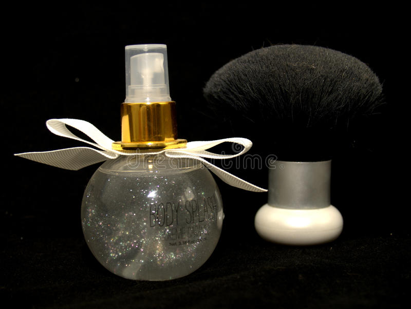 Perfume and brush. 56/5000 perfume and brush are essential components of every woman royalty free stock image