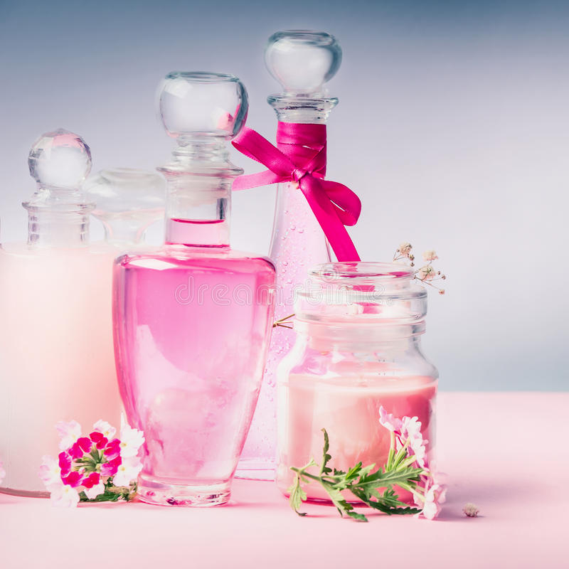 Perfume and Cosmetics setting on pastel light background, front view royalty free stock images