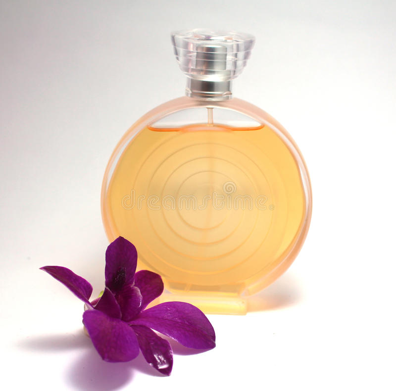 Perfume. A modern perfume with a flower stock photography