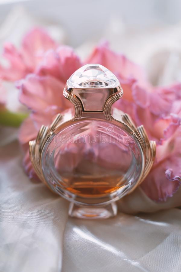 Perfume with pink flowers stock photos