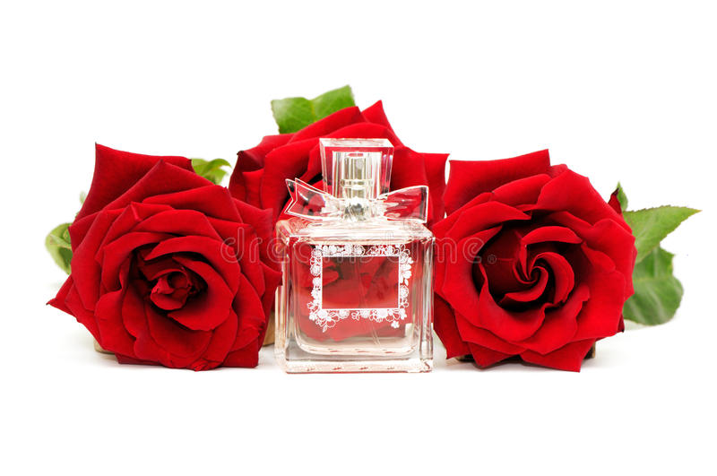 Perfume and roses stock photography