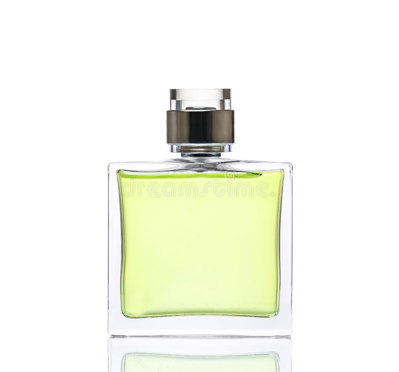 Perfume verde lujoso Concepto femenino de la belleza, fotografía del estudio de la botella de perfume - aislada en el fondo blanc fotos de archivo libres de regalías